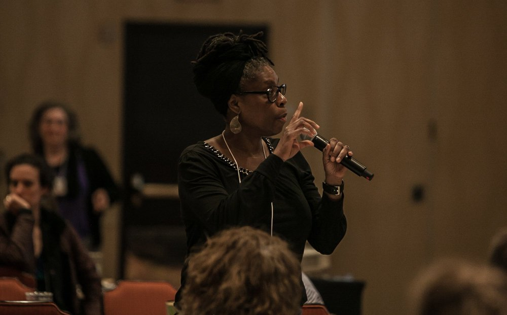 Dina Newman raising an issue during the symposium